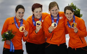 The gold medalists Netherlands' skaters pose during the victory ceremony for the women's speed skating team pursuit event at the Adler Arena in the Sochi 2014 Winter Olympic Games